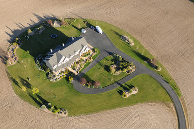 Aerial photo of a house surrounded by a plowed field - interesting shapes- Photography by Jim R Harris