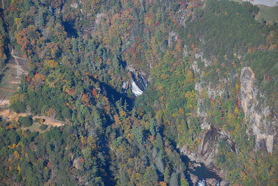 View of Hurricane Falls and suspension bridge at the bottom of Tallulah Gorge