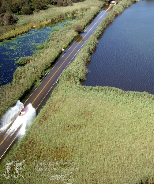 A truck driving through the flooded causeway after Irene.
