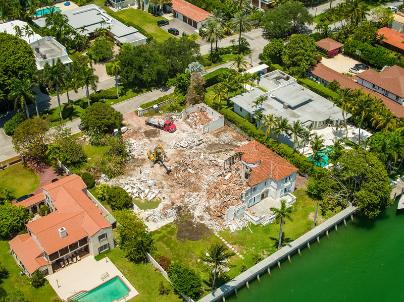 Aerial drone photo of a mansion being destroyed Miami Beach