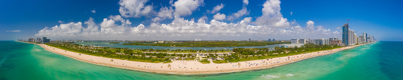 Aerial panorama Miami Beach Haulover with blue cloudy sky coastline scene