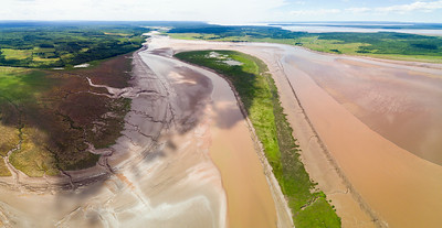 Aerial Big bend in the Maccan River estuary at low tide with surrounding dykelands dike lands Upper Bay of Fundy Nova Scotia