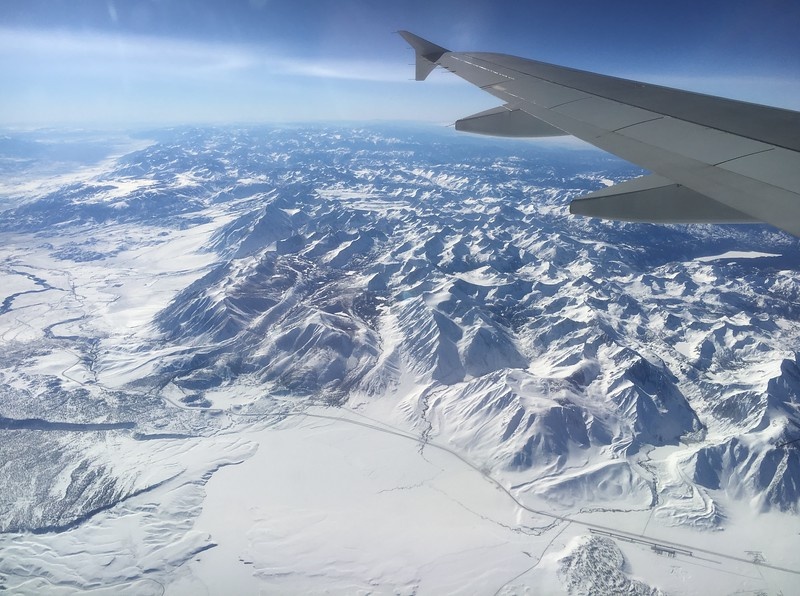 A frozen over Crowley Lake in the lower center of photo, with the Mammoth Lakes airport in the lower right.