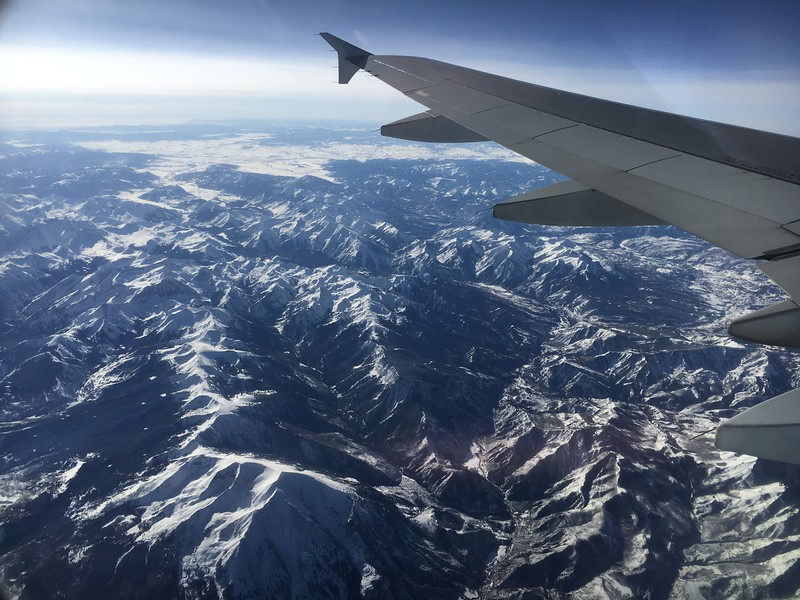 Mt Sopris is in the lower left. The Maroon Bells-Snowmass Wilderness in the middle-left of the photo. In the background is the open high plateau through which the Black Canyon of the Gunnison River flows.