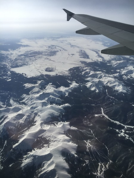 """Keystone Ski Resort in the lower right, with the mountain range that includes Independence, Keystone and Whale mountains in the lower center. Mt. Guyot, Bald Mountain, and Boreas Mountain in the center right (""""under"""" the plane's wing)."""