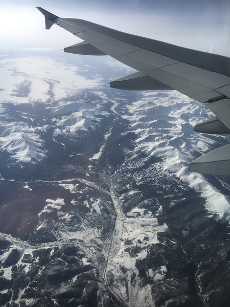 The town of Breckenridge, and Breckenridge Ski Resort. Under the plane's wing are Crystal Peak, Atlantic Peak, Quandary Peak, North Star Mountain, and others in that range.