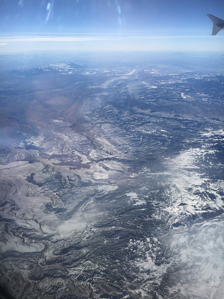 Capitol Reef National Park (center of photo) and the Henry Mountains (upper left), on American flight #615, Philly to SFO
