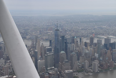 We were at 1,500 feet, which should be below the top of the spire, but it doesn't look like that from this photo. Brooklyn Bridge visible again just right of the wing strut.