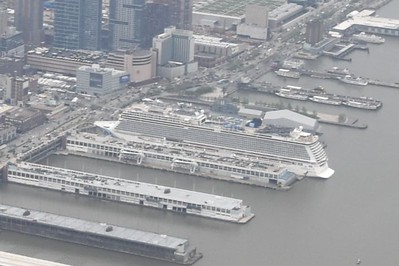 Notice how this modern cruise ship dwarfs the WWII aircraft carrier behind it