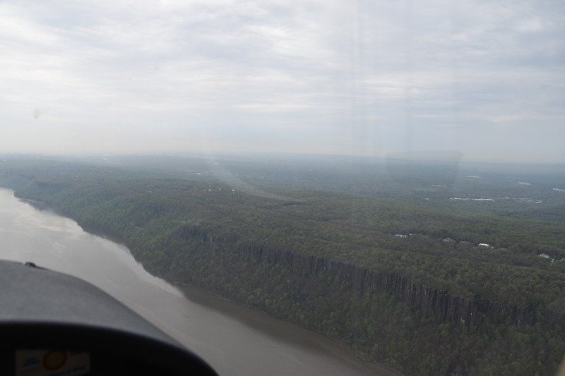 The Palisades and the Alpine Tower, an aircraft reporting point on the  Hudson River corridor.  However we were in contact with ATC so we didn't need to make the self-report calls.
