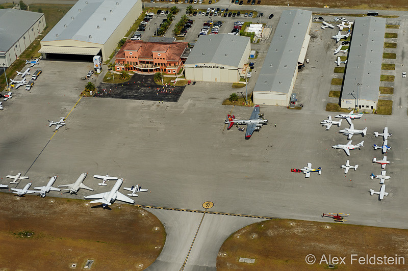 """Miami Executive airport.<br /> Note the B-17 """"Aluminum Overcast"""" parked by Landmark Aviation (orange building)"""