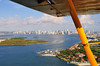 Fisher Island below, Miami in the distance, shot from a Super Cub