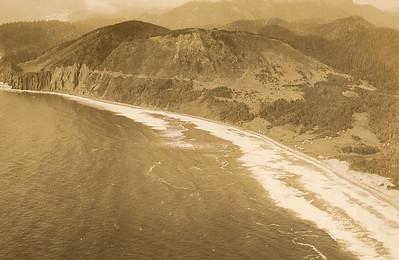 Taken early 1930s by Brubaker aerial studios. The south side of Neahkahnie has few trees.
