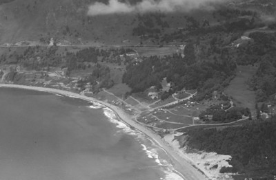 Taken 1946. Work has begun on a road in front of Classic Ridge connecting Neahkahnie with Manzanita.