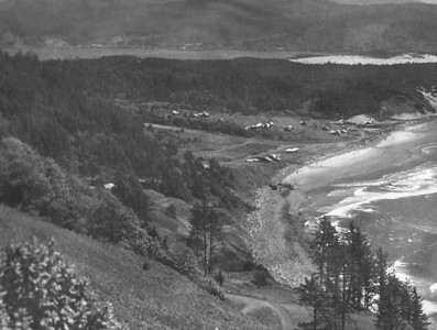 Taken late 1930s by Brubaker aerial studios. Rocks on the beach have reappeared due to decreted level of sand resulting from detereoration of the jetties.