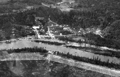 Taken in 1929 and probably the first aerial photo of Nehalem. The large white rectangle on the near left is a flaw in the print, not a building. A close view of this image reveals the Nehalem school prior to building the south wing with the pool.