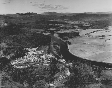 Looking north over Nehalem toward Saddle Mountain. Taken 1950 by Boersig aerial studios.