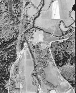 Aldervale Bridge (aka Scovill Bridge) near center of image. Taken 1960 for Tillamook County Assessor.