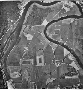 Highway 101 bridge at lower left, Nehalem River running through image from lower right. Taken 1965 for Crown Zellerbach Corporation.