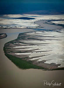 The tides only cover the marsh flats this far up the Sound only on Spring tides so the salt dries top a brilliant white.