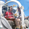 Fitchburg Municipal Airport held an Aero Fair on Saturday for all ages. Jacen Smakal, 10, of Lunenburg gets ready to take a flight in a helicopter with pilot Steve Brousseau. SENTINEL & ENTERPRISE/JOHN LOVE
