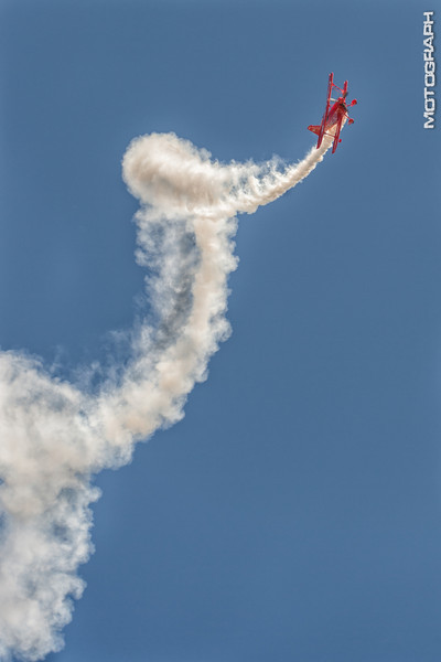 Sean Tucker corkscrews the Oracle Challenger Biplane