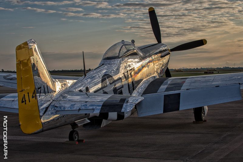 Sunlight reflects off the polished duraluminum on this North American P-51 Mustang