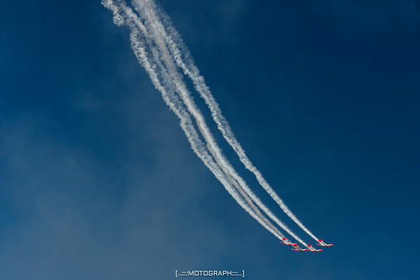 The Aeroshell Aerobatic Team perform during Saturday's performance