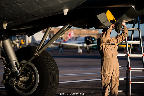 Texas Raiders crewman Curt Rowe performs pre-flight inspections on the majestic B-17 Flying Fortress