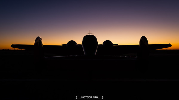 The Beech 18 of Matt Younkin catches the beautiful first light of Saturday's performance