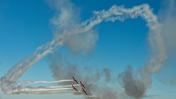 The Aeroshell Aerobatic Team close the loop in their AT-6 Texans