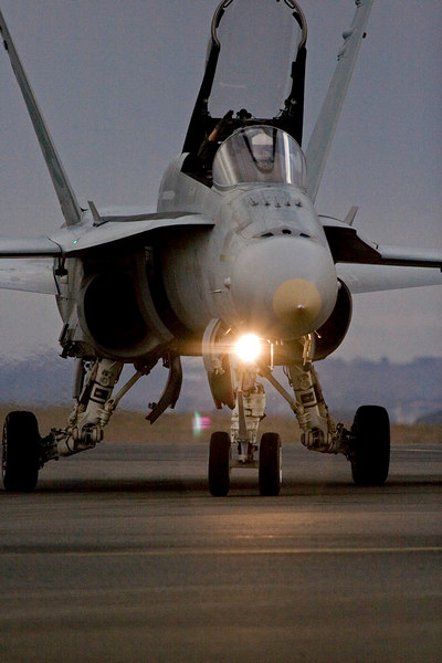 An RAAF F/A18A Hornet turns off the runway. A similar shot appears on the front cover of the Australian International Airshow 2007 pictorial review .