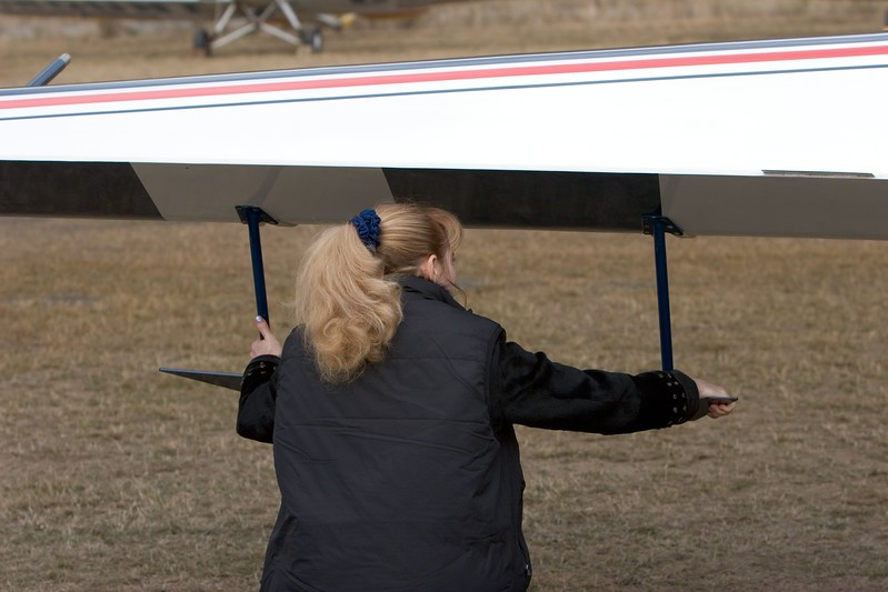 "Svetlana checking the aileron spades which give a measure of aerodynamic ""power assistance"" to the full span control surfaces."