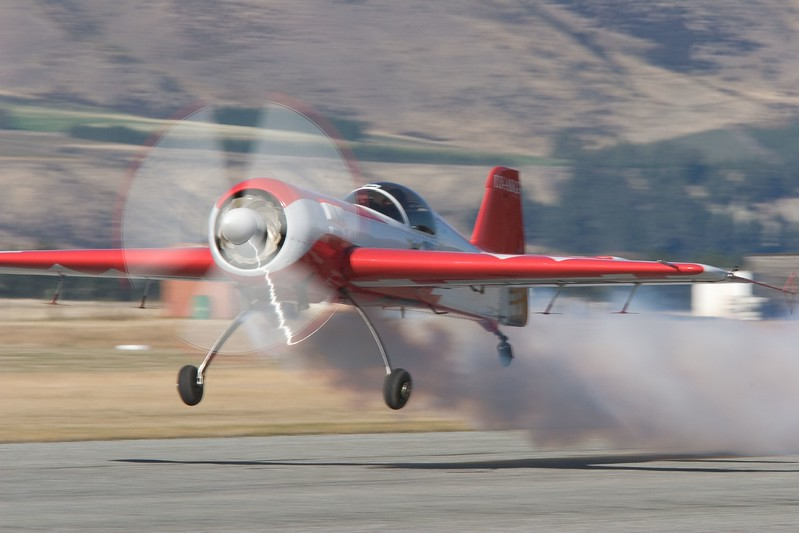 Jurgis Kairys lifts off runway 29 at Wanaka in his SU-26. Moments later he flicked the 1,100 kg aircraft inverted, pushed hard on the stick and used the Vedeneyev M14 PF's 400 BHP to make an outside pitch to the vertical and climb away.