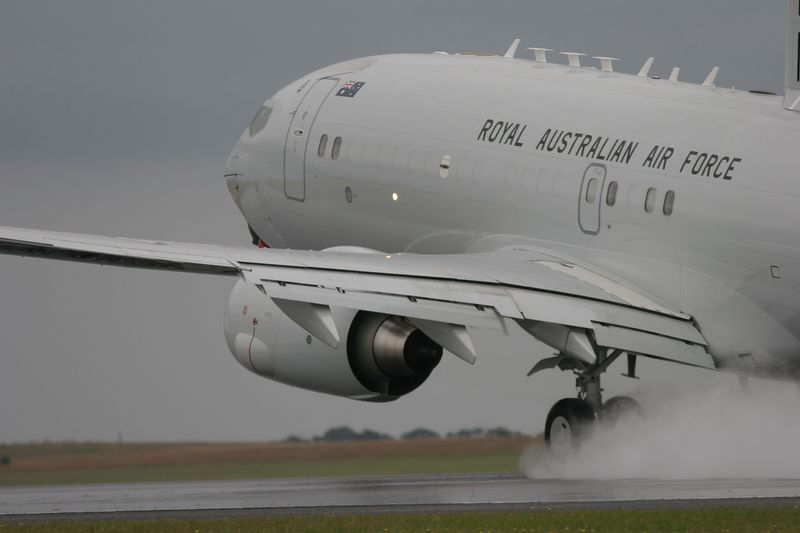 RAAF Boeing 737 7ES Rotates on a wet runway at Avalon. This image appeared in the official Avalon Airshow book.