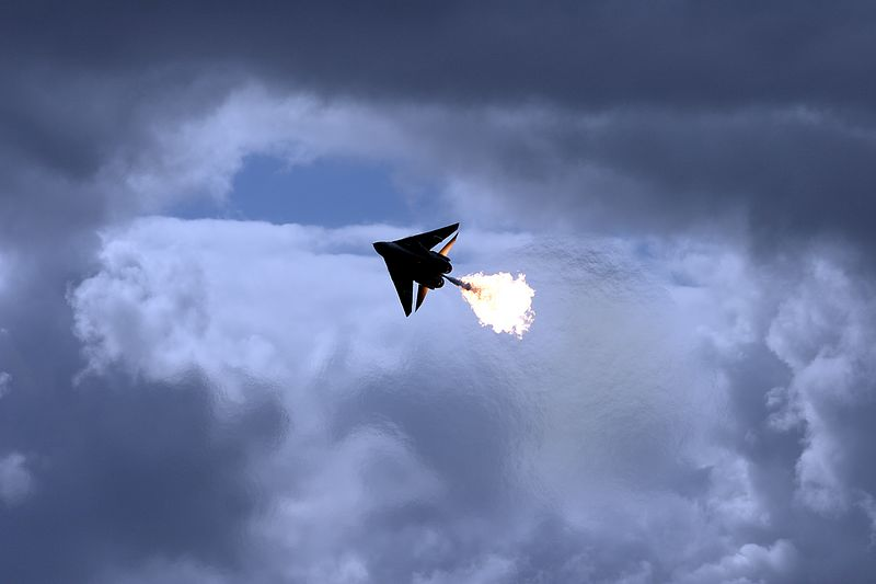 Burning holes in the sky. F-111 A8-272 dumps fuel. A popular past-time for this specific aircraft.