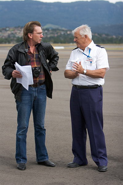 Keeping up PR. John Brooker briefs the local newspaper reporter who flew on the Connie.