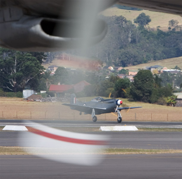 Lucky shot with Bob Eastgate's Mustang taking off seen through the idling prop of the Connie.
