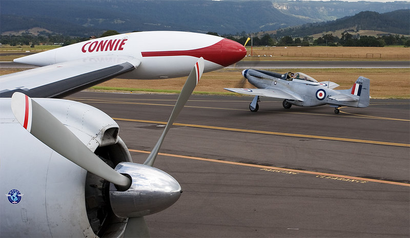 Bob Eastgate's Mustang taxis past Connie on the first flight on 29th April 2006.