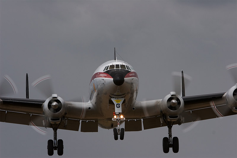 """Historical Aircraft Restoration Society's  (HARS) Lockheed Super Constellation, VH-EAG """"Southern Preservation"""", on late finals and just about to cross the fence at Albion Park. Darkening sky behind adds impact. (Photographic details for the anoraks: 1/160th sec @ f10, 100 ISO. Canon 20D, 70-200 mm l (IS) lens with Kenyon Labs KS-4 gyro stabiliser.) HARS website:  <a href=""""http://www.hars.org.au/"""">http://www.hars.org.au/</a>"""