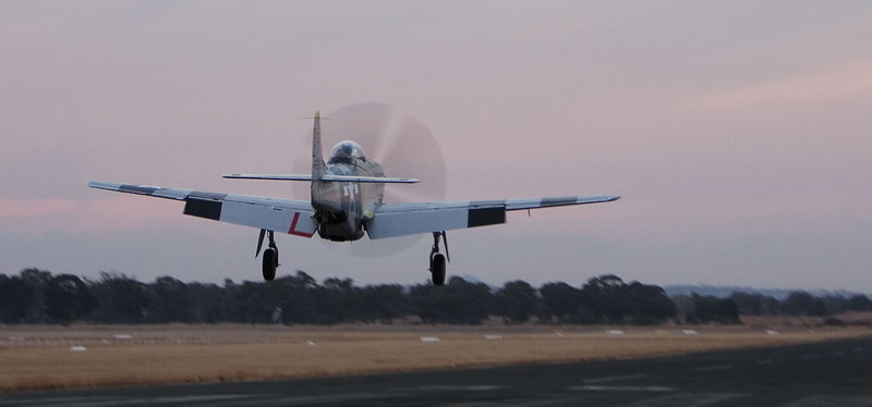 P-51 Mustang completes a final circuit to runway 36 late in the afternoon.
