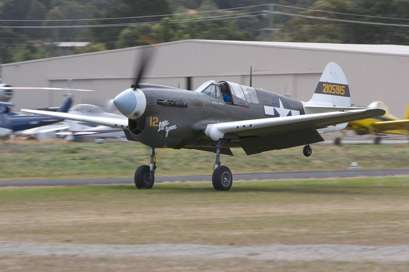 "Curtiss P-40N/42 Warhawk (s/n 42-105915) VH-KTI ""Little Jeanne"" touches down.  Photo appears in issue #10 of Aero Australia Magazine on sale now.<br /> <br /> This aircraft is not a Kittyhawk and is often confused with the  P-40E Kittyhawk. (However,in RAF/Commonwealth service, this type was referred to as a ""Kittyhawk MK IV)<br /> <br /> Serial #: 42-105915<br /> Construction #: 29677<br />  History: <br /> Intended for delivery to Chinese AF.<br /> Impressed into service with USAAC.<br /> Recovered from Tadji, West Sepik, PNG, 1974 where it had been abandoned.<br /> Malcom Long Collection, Melbourne, Victoria, 1974-1988.<br /> - Displayed RAAF Museum, RAAF Point Cook, Victoria, 1977.<br /> - Displayed Chewing Gum Field Museum, Tallebudgera, Queensland, 1980-1985.<br /> - Displayed Drage Air World, Wangaratta, Victoria, 1985-1991.<br /> Jack McDonald & John Rayner, Melbourne, Victoria, 1991-1992.<br /> - Restoration to airworthy.<br /> Information courtesy  <a href=""http://www.warbirdregistry.org/p40registry/p40-42105915.html"">http://www.warbirdregistry.org/p40registry/p40-42105915.html</a> and also <br /> <a href=""http://cgibin.rcn.com/jeremy.k/cgi-bin/usafSearch.pl?target=&content=Kittyhawk+IV"">http://cgibin.rcn.com/jeremy.k/cgi-bin/usafSearch.pl?target=&content=Kittyhawk+IV</a>"