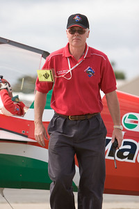 Always busy. The life of an airshow director is always on the go. Martin Robson sorts out the timing for Pip Boorman's race with Todd Kelly.
