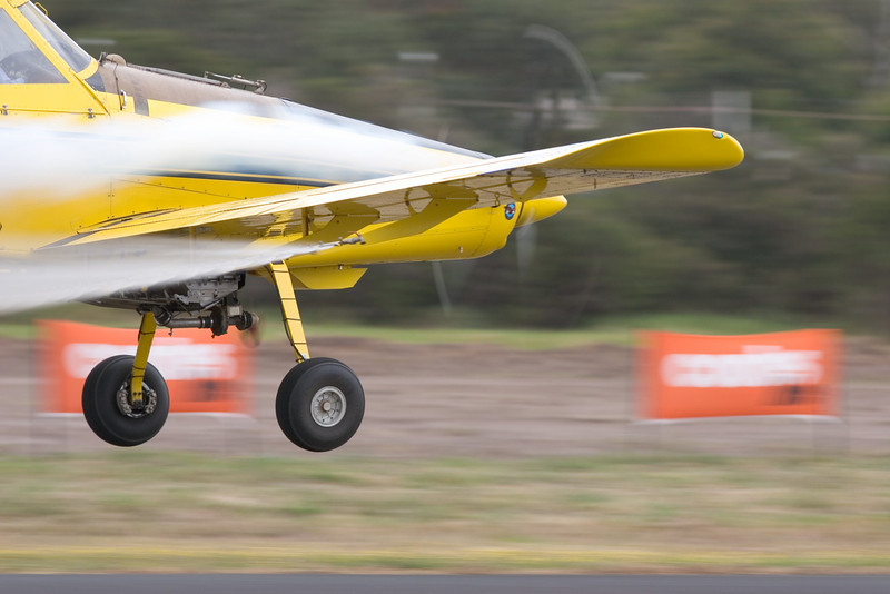The turbo-prop Air Tractor demonstrated aerodynamic airflow over its wing with smoke from the exhaust and water from the spray booms. The stationary boundary layer over the wing's camber is very evident and shows how far back the centre of aerodynamic pressure lives on this airfoil.<br /> <br /> The small prop under the fuselage drives a centrifugal compressor for the spray mechanism.  Looking suspiciously like an automotive turbocharger adapted for the task.