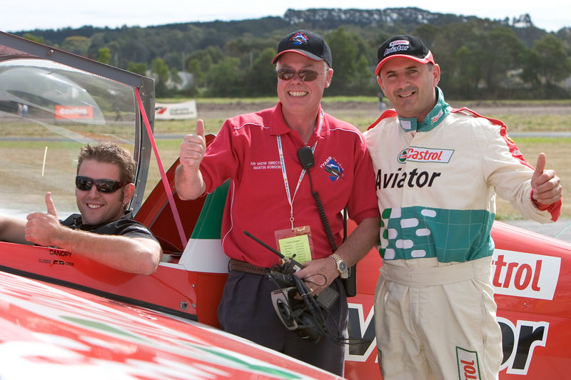 "Honour satisfied all round. Todd Kelly and Pip Borrman after their match races with Tyabb On Show airshow Director Martin Robson.  Pip's Castrol Aviator Zivko Edge 540, VH-PIP, is one of only 6 in the world.<br /> See Pip's Edge Aerobatics website : <a href=""http://www.edgeaerobatics.com.au/"">http://www.edgeaerobatics.com.au/</a>  for more information on this exciting combination.<br /> <br /> Sadly I have to record the death of my dear friend Martion Robson in a Busby Mustang on Sunday, 11th January 2009.<br /> <br /> <br /> See Todd's website for details of his motor racing and an account of the race between them at Tyabb:  <a href=""http://www.toddkelly.com.au"">http://www.toddkelly.com.au</a>"