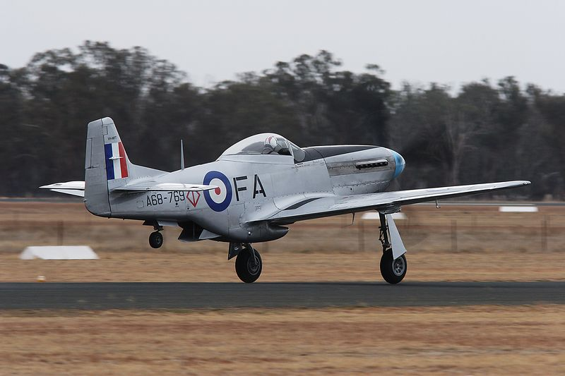 Mustang lifts off at Temora.  CAC CA-18 Mustang (VH-MFT  - originally A68-110) presented as A68-769 (North American P51D. 25 NT). Operated by Caboolture Aviation Museum and flown by Tony Alder.