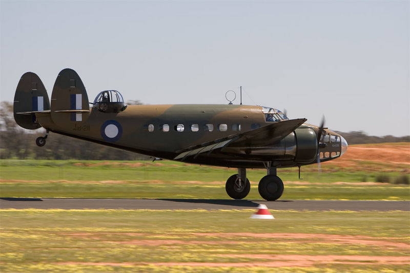 "The Temora Aviation Hudson IV A16-112 alias A16-211. Further information is available on the Temora Aviation Museum website :  <a href=""http://www.aviationmuseum.com.au/aircraft/Hudson.cfm"">http://www.aviationmuseum.com.au/aircraft/Hudson.cfm</a><br /> <br /> This photograph appears in issue 9 of Aero Australia Magazine on pages 28/20.  Landing at Temora with the port wheel still not on the runway, the tail held high and the engines idling."