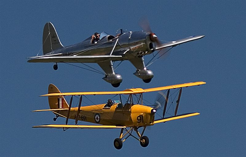 Close formation between the Tiger Moth and the Ryan STM or the foreshortening effect of a 500mm lens?
