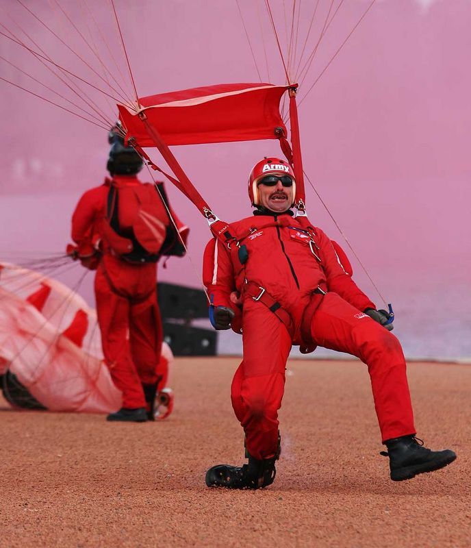 Australian Army Red Berets Parachute Display Team member, R.D.Smith, skates in.<br /> <br /> No he didn't hurt his leg!<br /> <br /> Pink smoke is from the wind-direction smoke canister.
