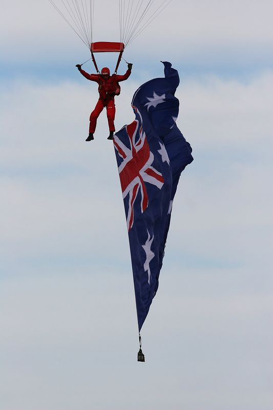The Australian flag makes a graceful touchdown on VP Day at Canberra.